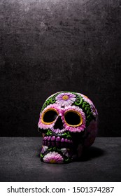 Typical Mexican skull painted on black background. Dia de los muertos.