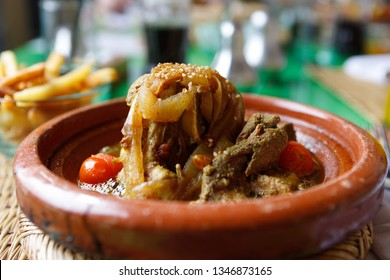 Typical Moroccan dish: Lamb tagine with herbs, onions, tomatoes and vegetables, served hot in a clay pot (Marrakesh, Morocco, Africa)