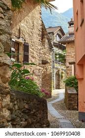 Typical narrow rural Swiss mountain village street in Southern Switzerland, Canton of Ticino near Bellinzona