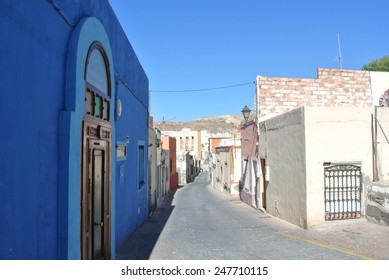 Typical narrow street in the Andalusian seaside resort Almeria, on a sunny summer morning.