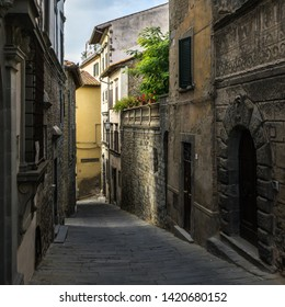 A typical narrow street in Cortona historic center. Cortona is a beautiful medieval town in Tuscany, Italy