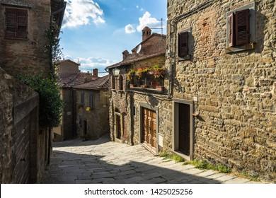 A typical narrow street in Cortona historic center. Cortona, Tuscany, Italy, September 2018
