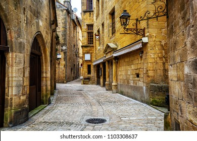 Typical narrow street in the medieval Old Town of Sarlat la Caneda, Perigord, France
