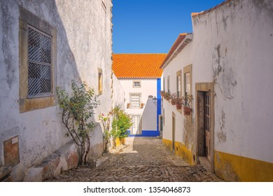 A typical narrow street in the medieval town of Obidos, Portugal.