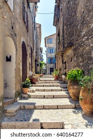 typical narrow street with tourists in St Paul de Vence, France.