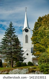 typical new england church with white steeple near Waterville VT