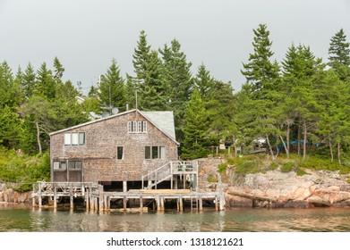 Typical New England shingled waterfront house on Schoodic Peninsula near Acadia National park, Maine