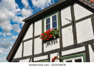 A typical Nordic or Scandinavian home with a colorful flowerbox outside it's window in the resort town of Warnemunde, Germany on the coast of the Baltic Sea.