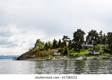 typical norway sea shore countryside landscape view with islands and trees