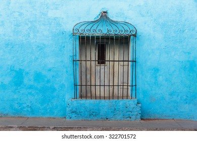 Typical old door decoration in the street of Trinidad, Cuba