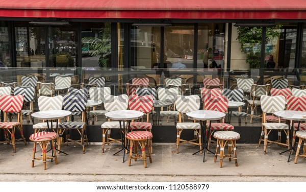 Typical Outdoor Cafe, Chairs and Tables in Paris France