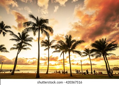 Typical picturesque sunset along Waikiki Beach at golden hour