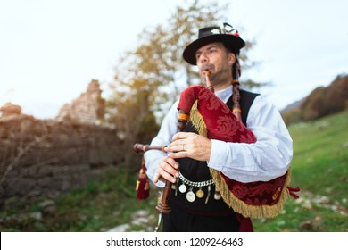 Typical player in traditional bergamo bagpipe from the alpine valleys of northern Italy.