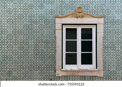 Typical Portugal architecture with colored tile (azulejos) in Algarve. Historical building with window.