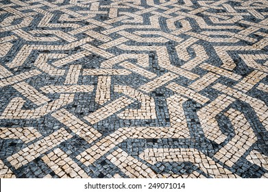 Typical portuguese cobblestone hand-made pavement in Portugal, Lisbon.