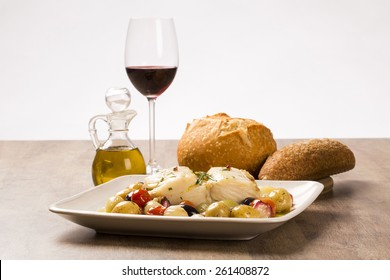 A typical Portuguese dish with codfish called Bacalhau do Porto in a original portuguese plate