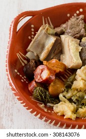 typical portuguese dish on ceramic plate on wooden background