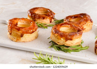 Typical Portuguese pastry Glorias, tender puff pastry topped with handmade caramel candy and special sugar syrup.