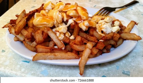 Typical poutine with fries, cheese curd and gravy in Quebec, Canada