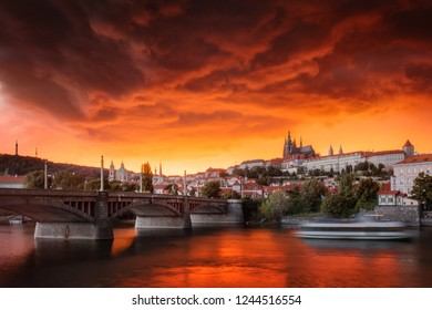 Typical Prague panorama of castle and manes bridge in Czech Republic at the beautiful stormy sunset.