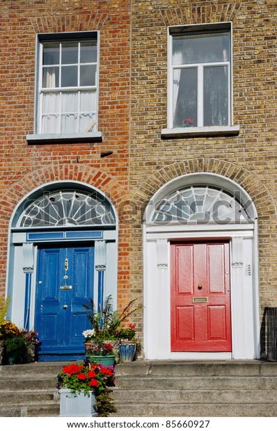 Typical red and blue Georgian doors. Dublin, Ireland