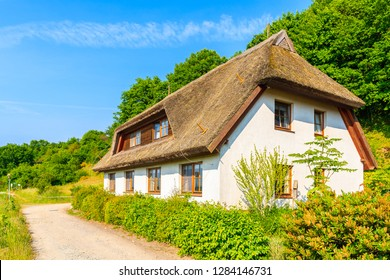 Typical red brick house with straw roof in Moritzdorf village, Baltic Sea, Germany