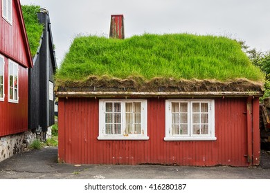 Typical red cottage with thatched roof in Torshavn, Faroe islands.