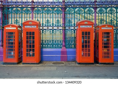 Typical red phone booths in a row on smithfields market or London Central Markets, the largest wholesale meat market in the UK and one of the largest of its kind in Europe