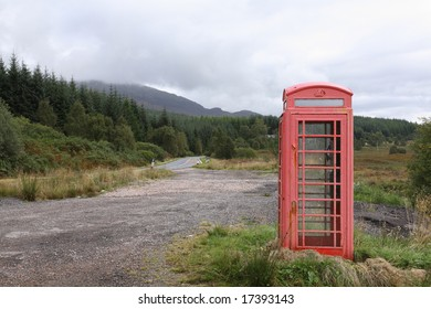 A typical red UK telephone box in a remote location in the Scottish Highlands