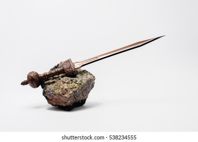 Typical Roman sword on green rock