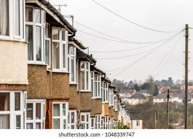 Typical row of houses in British city on cloudy day