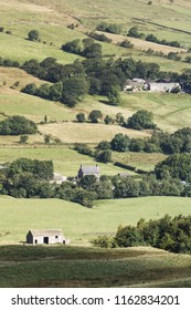 Typical rural England scene of rolling hills and farm houses in Derbyshire countryside