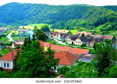 Typical rural landscape and peasant houses in  the village Apold, Transylvania, Romania. The settlement was founded by the Saxon colonists in the middle of the 12th century