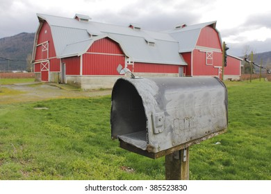 A typical rural mailbox that has seen many years of service/Country Rural Mailbox/A typical rural mailbox that has seen many years of service.