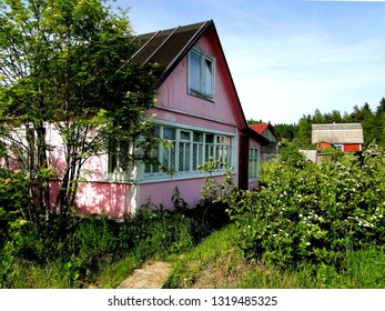 Typical Russian cottage, dacha in the small village. Dacha is a seasonal or year-round second home, often located in the exurbs of Russian and other post-Soviet countries