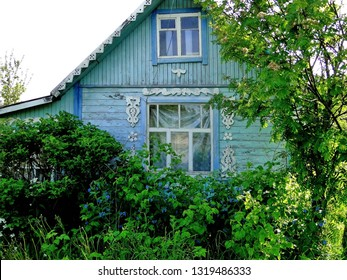 Typical Russian cottage, dacha in the small village. Dacha is a seasonal or year-round second home, often located in the exurbs of Russian and other post-Soviet countries. Carved wood decorations