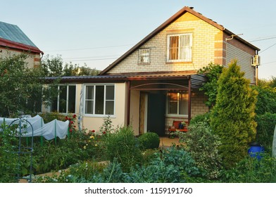 A typical Russian dacha is a place for growing vegetables and fruits. Subsidiary farm. Vacation home.