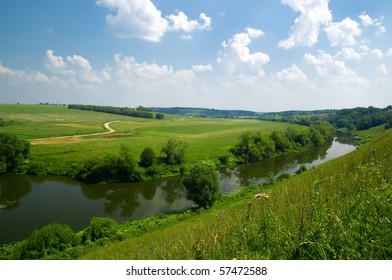 Typical Russian landscape with river and a clear blue sky.