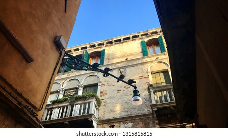 Typical scene of Venice, Italy, with old houses and pigeons in the sun during a beautiful autumn day