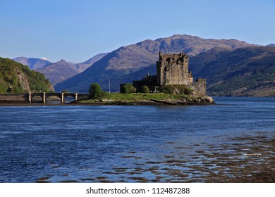 The typical scottish castle of Eilean Donan in a sunny summer day