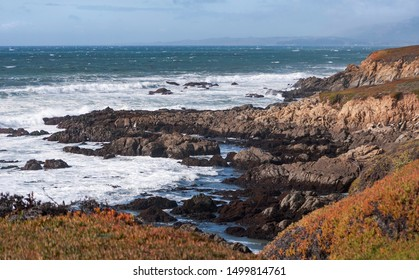 a typical section of the rocky pacific coast shore line near cambria california showing the bluffs and surf