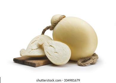 Typical Sicilian Seasoned Provolone with a sliced provola on a chopping board On white background