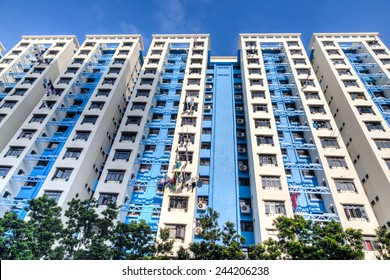 A typical Singapore highrise public housing estate against a blue sky.