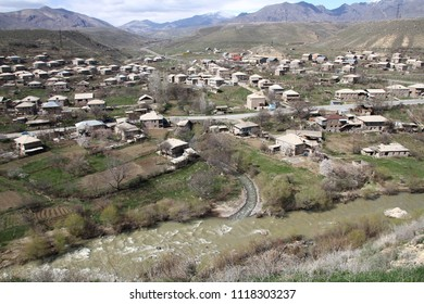 Typical small armenian village Areni in Caucasian mountains near Arpa River in the Vayots Dzor Province in early spring, aerial view. Areni is best known for its wine production and ancient church.
