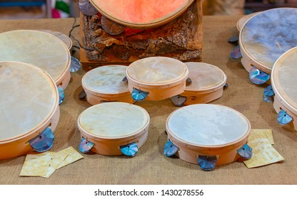 Typical small handmade Salento tambourines for sale on a stall during a festival