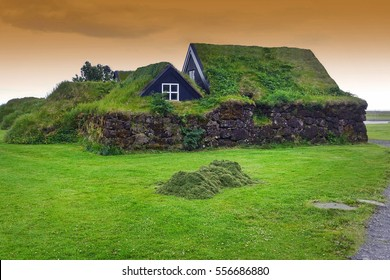 Typical small houses in Iceland. Old architecture with grassy roof.
