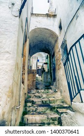 typical small pass street in Ostuni  - ancient white town in Italy