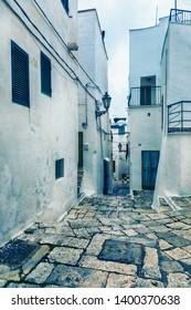 typical small street in Ostuni  - ancient white town in Italy