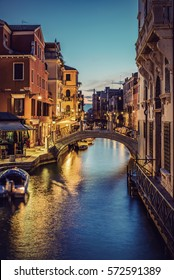 Typical small Venetian Canal in the evening, Venice (Venezia), Italy, Europe, Vintage filtered style