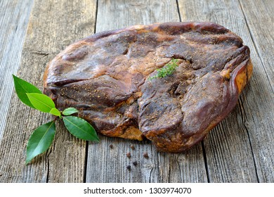 Typical South Tyrolean bacon in one piece on a rustic table
